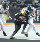 LA Kiss Quarterback Kenny Guiton being stopped on the keeper. Photo Credit Jevone Moore / news4usonline.com