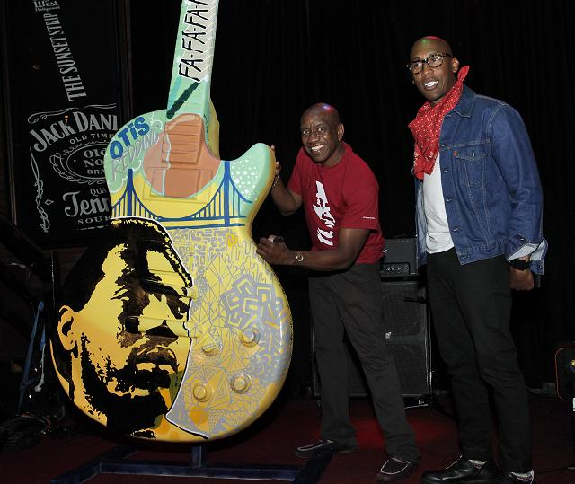 Otis Redding III autographing the Gibson Art Guitar in tribute to his father with artist Raphael Saadiq.  Photo credit:  Randal Michelson