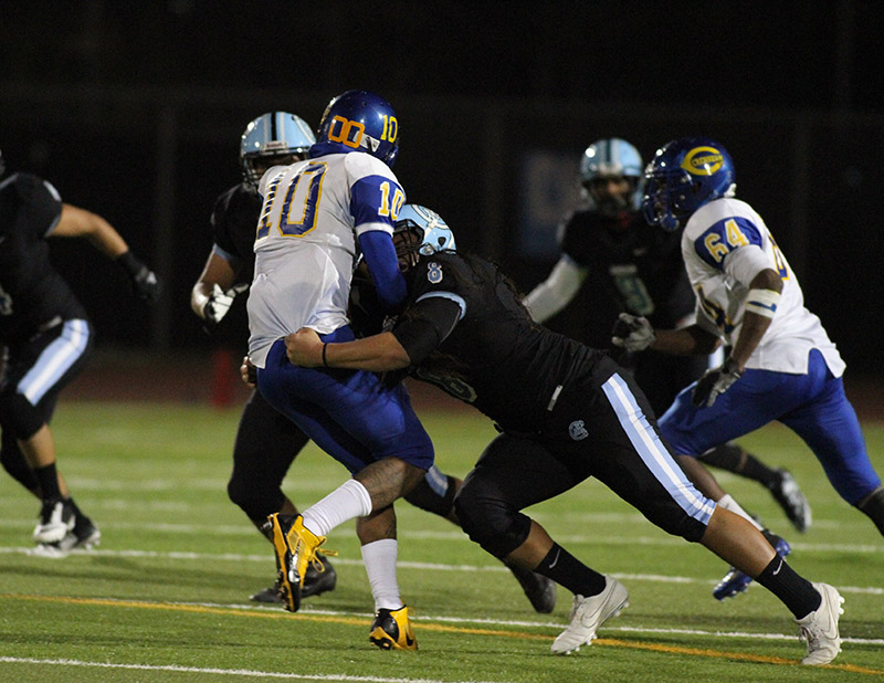 Carson's Solid Defense : LB Manuopuava Tui-Enesi #8 on the tackle of RB Marcus Walton #10