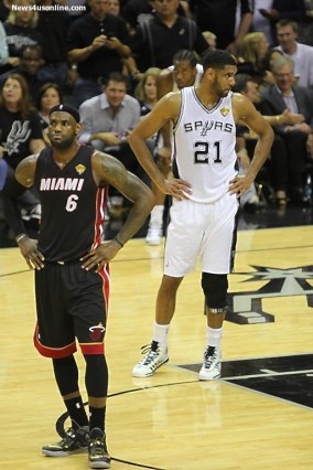 LeBron James in a pensive mood during Game 5 of the NBA Finals with Tim Duncan looking the other way. Photo Credit: Antonoio Uzeta/News4usonline.com