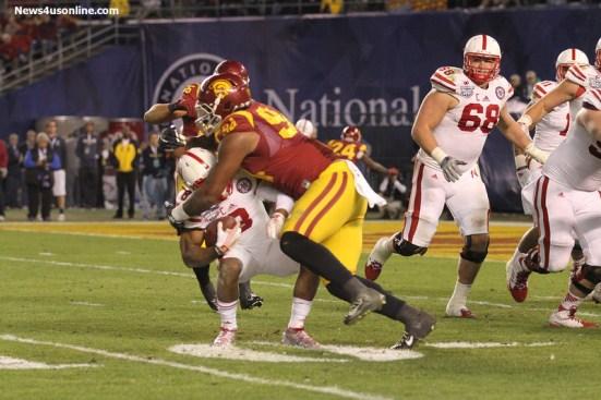 Defensive end Leonard Williams stops a Nebraska runnin gback in his tracks with a wicked hit. Photo Credit: Jevone Moore/News4usonline.com