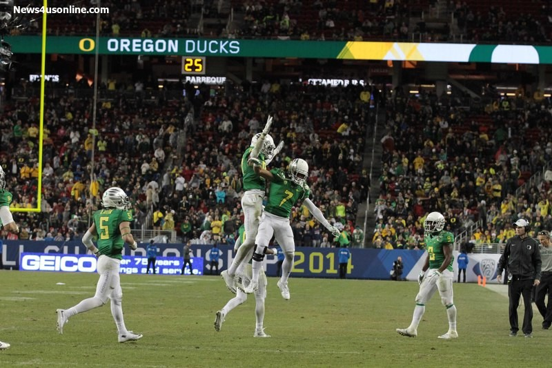 Oregon players celebrate another big play against Arizona in the Pac-12 Conference Champiionship. Photo Credit: Jevone Moore/News4usonline.com