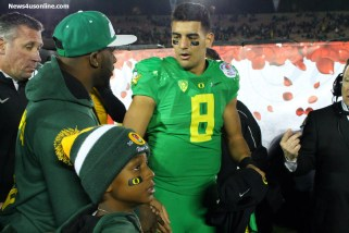 Oregon quarterback Marcus Mariota receives some congratulations after the Rose Bowl. Photo by Dennis J. Freeman/News4usopnline.com