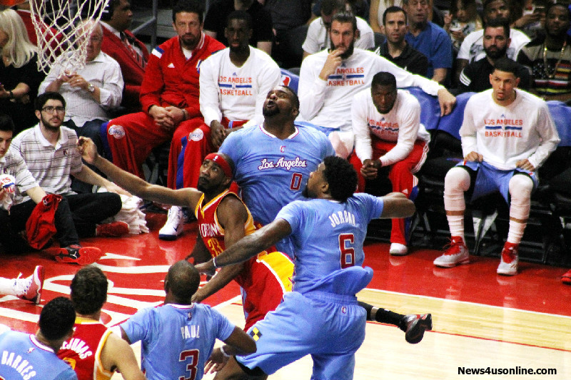 """Clippers Glen """"Big Baby"""" Davis and DeAndre Jordan tries to block Corey Brewer from getting to the basket on Sunday, March 15, 2015. Photo Credit: Dennis J. Freeman/News4usonline.com"""