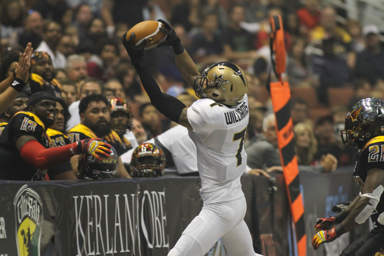 JJ Raterink favorite receiver tonight on one of his seven catches. Photo by Jevone Moore