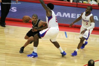 The Spurs' Tony Parker slides around DeAndre Jordan in Game 2 of the first round NBA playoffs matchup between the San Antonio and the Los Angeles Clippers at Staples Center on Wednesday, April 22, 2015. Photo Credit: Dennis J. Freeman/News4usonline.com