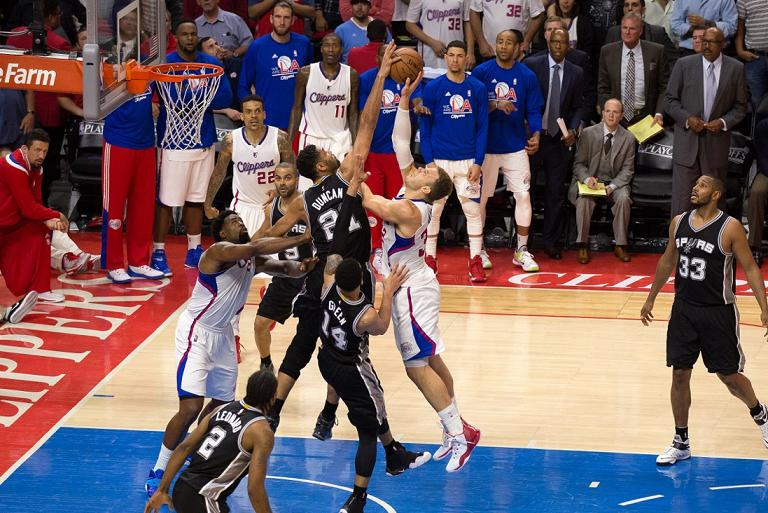 Blake Griffin has his shot blocked by the spurs' Tim Duncan as time winds down in the fourth quarter in Game 5 at Staples Center. Photo Credit: Tiffany Zablosky/News4usonline.com