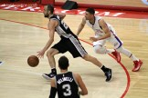 Austin Rivers gives chase to the Spurs' Manu Ginobili in Game 2. Photo Credit: Dennis J. Freeman/News4usonline.com