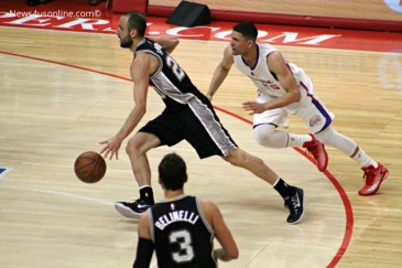 Austin Rivers gives chase to the Spurs' Manu Ginobili in Game 2. Photo Credit: Dennis J. Freeman/News4usonline.com
