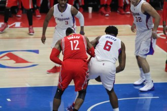 DeAndre Jordan of the Los Angeles Clippers, battles Houston Rockets center Dwight Howard for a rebound in Game 6 of the second round series between the two teams. The Rockets rallied from a 16-point deficit to defeat the Clippers 119-107. Photo by Jevone Moore/News4usonline.com