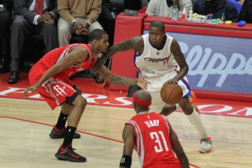 The Clippers' Jamal Crawford tries to get past journeyman Trevor Ariza in the Clippers-Rockets Game 6 matchup. Photo by Jevone Moore/News4usonline.com