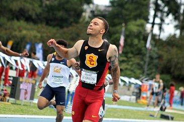 USC sprinter Andre De Grasse makes it home in the men's 100 meters. De Grasse posed a winning time of 9.97 seconds. Photo by Dennis J. Freeman/News4usonline.com