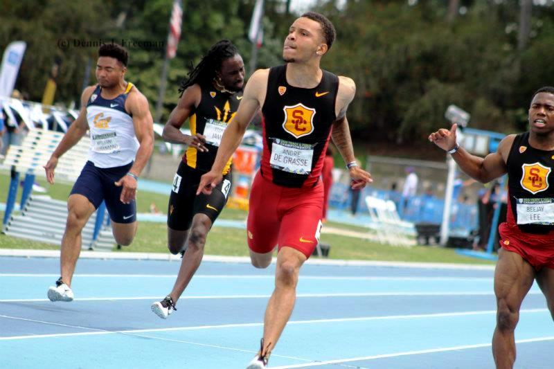 Blazing to victory: USC sprinter Andre De Grasse crosses the finish line in the 100 meters in record time at the 2015 Pac-12 Conference Track and Field Championships on Sunday, May 17, 2015. Photo by Dennis J. Freeman