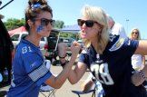 A Detroit Lions fan and a San Diego Chargers supporter get into a friendly battle of team. Photo by Dennis J. Freeman/News4usonline.com