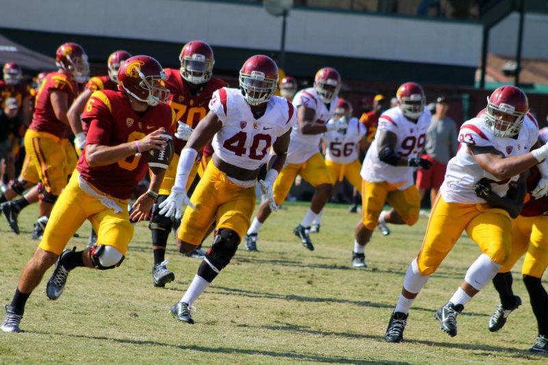 USC linebacker Jabari Brown (40) goes after quarterback Cody Kessler during a fall training camp practice. Photo by Dennis J. Freeman