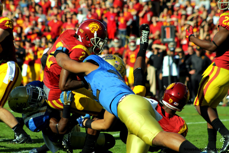 Adoree' Jackson (2) is wrapped up by several UCLA defenders. Photo by Dennis J. Freeman/News4usonline.com