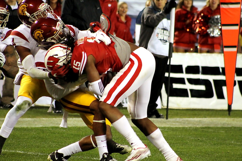 USC defenders pile on to make a play. Photo by Dennis J. Freeman/News4usonline.com