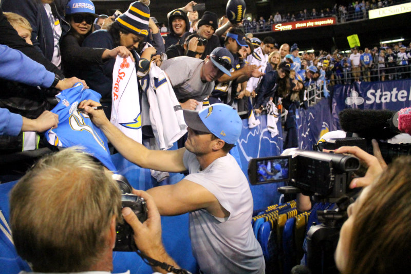 Quarterback Philip Rivers signs autographs after the San Diego Chargers final home game of the 2015 season. Photo by Dennis J. Freeman/News4usonline.com