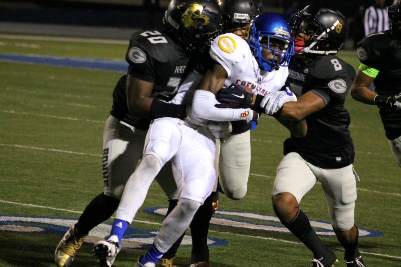 Narbonne defenders swarm all over a Crenshaw offensive player. Photo by News4usonline.com