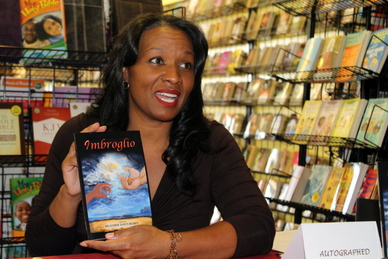 """""""Imbroglio"""" author Heather Dawn Robin holds court with a book signing in Inglewood, California. Photo by Dennis J. Freeman/News4usonline.com"""