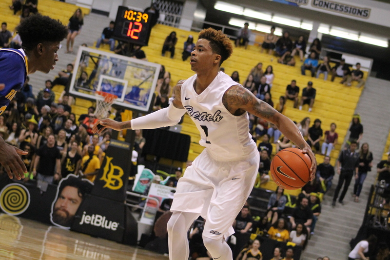 Long Beach State's Nick Faust getting ready to put a UC Riverside defender into the popcorn category.