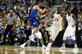 Duke's Grayson Allen is caught midair trying to get rid of the ball.