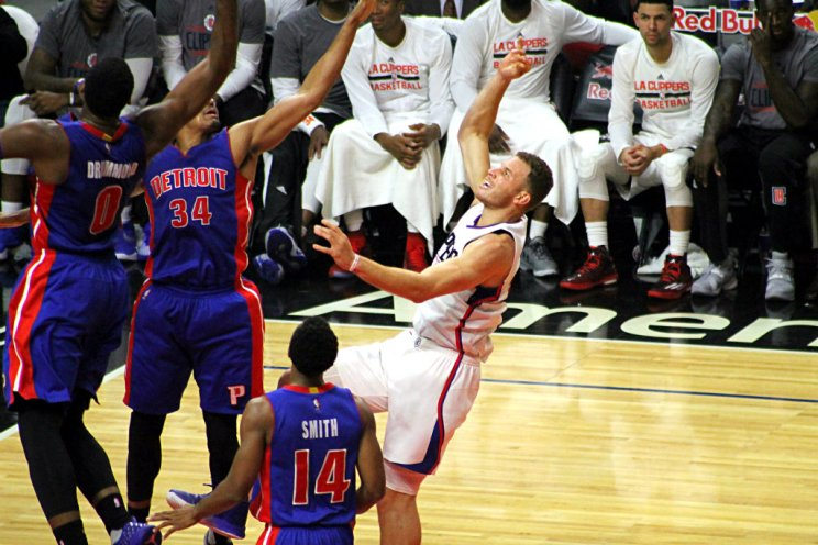 Blake Griffin gets this jumper off against a Detroit Pistons defender. Photo by Dennis J. Freeman/News4usonline.com