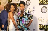 Emryi Crutchfield (left), who played a young Kizzy in the 2016 mini-series Roots, receives a warm greeting from co-star Emayatzy Corinealdi. Photo by Dennis J. Freeman/News4usonline.com