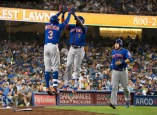 New York Mets shortstop, Jose Reyes, celebrates with teammate, Curtis Granderson, after hitting a two run homer in the top of the 7th inning and knocking Clayton Kershaw out of the game. Granderson had two home runs on the night. Kershaw gave up a career-high four home runs in Monday's game. Photo by Astrud Reed for News4usonline