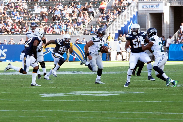 Seattle Seahawks Russell Wilson on the run against the Los Angeles Chargers in preseason action. The Seahawks defeated the Chargers, 48-17. Photo by Astrud Reed/News4usonline