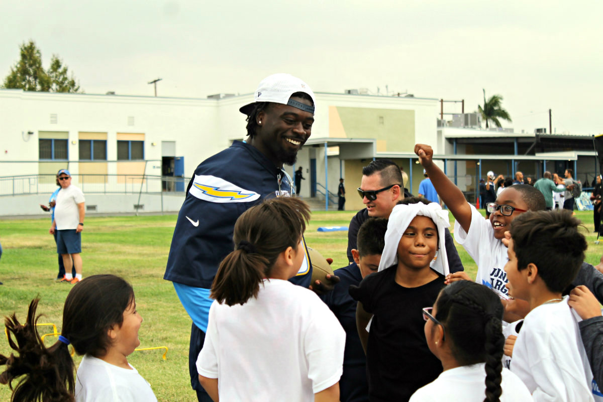Chargers, students bring their fun hats to Play60 event