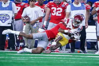 A USC wide receiver gets the blanket treatment by the Ohio State defense. Photo by Michael Lark for News4usonline