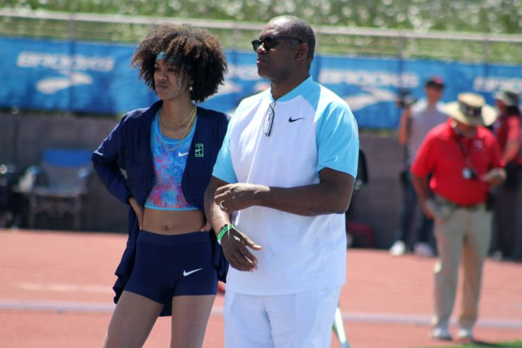 Vashti Cunningham (left) confers with her famous football father, former NFL quarterback Randall Cunningham, in between high jumps at the 2018 Mt. SAC Relays. Cunningham won the high jump event with a leap of 6 foot, 3 inches. Photo by Dennis J. Freeman for News4usonline