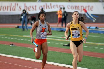 Iowa's Mallory King (right) fends off an Illinois runner in the women's invitational 4x400 relay. Iowa finished sixth in the race. Illinois came in seventh place with a time of 3.41:53. Photo by Dennis J. Freeman for News4usonline