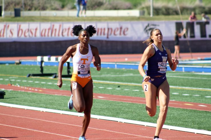 Iman Brown (23.71) of Washington edges out Tennessee runner Maia McCoy (23.74) in the women's open 200 on Day of the 2018 Mt. Sac Relays. Photo by Dennis J. Freeman for News4usonline