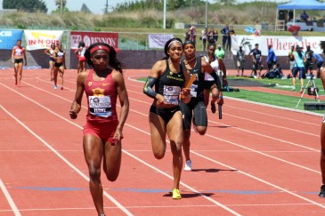 """Twanisha Terry (left) anchors the USC women's """"A"""" 4x100 relay team to a victory at the Mt. Sac Relays on Saturday, April 21, 2018. USC finished with a time of 42.57 to claim first place. Photo by Dennis J. Freeman for News4usonline"""