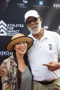 World champion figure skater Tai Babilonia with 1968 Olympian Dr. John Carlos at the Athletes for Impact Awards. Photo by Jada Stokes for News4usonline