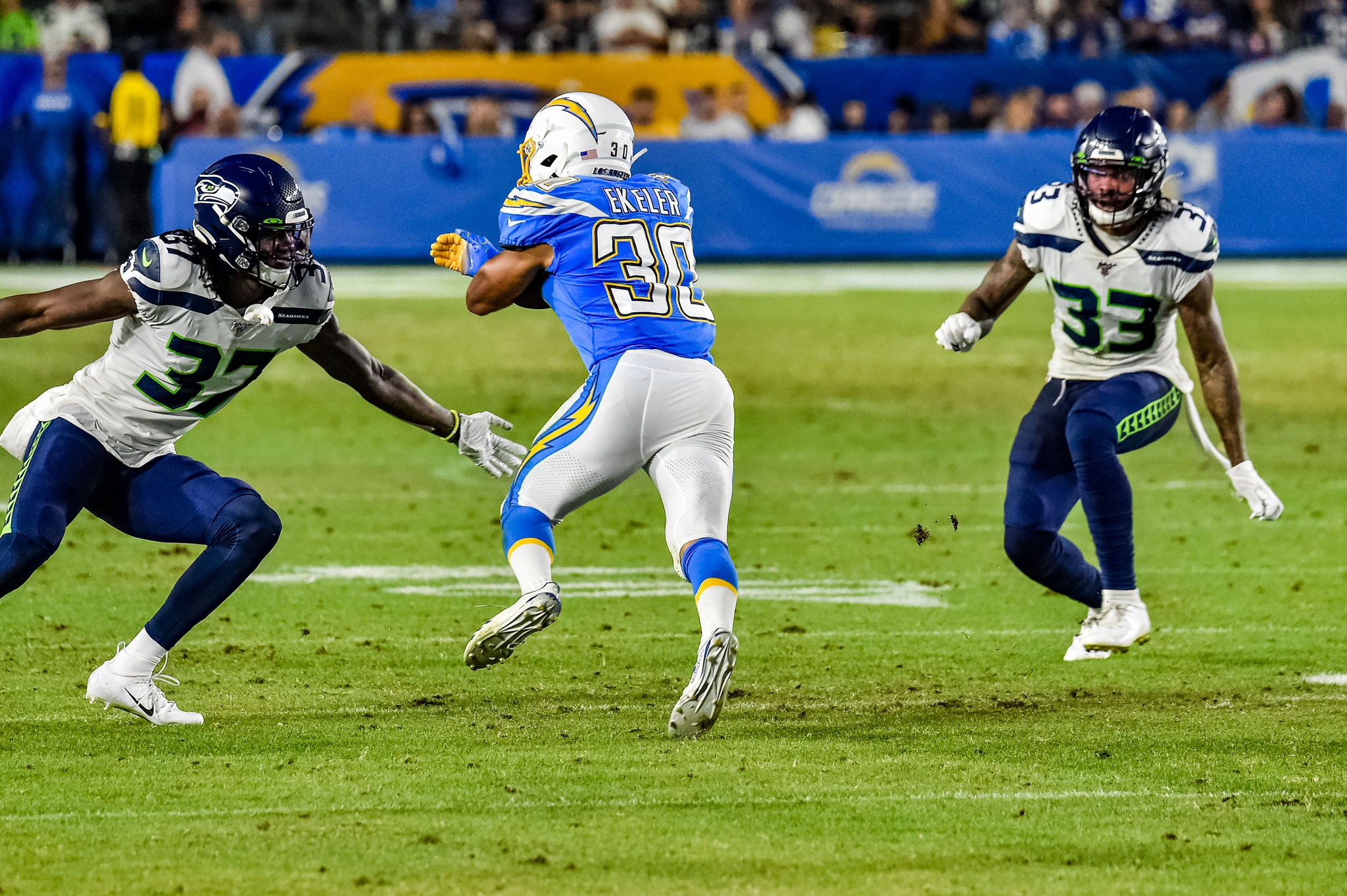 © Mark Hammond/News4usonline - Aug. 24, 2019 - Seahawks vs. Chargers - Chargers Austin Ekeler (30) looking for a hole to run against the Seattle defense.