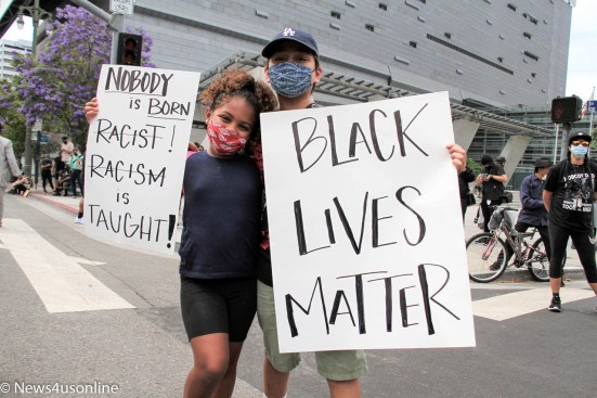 Two young demonstrators share their thoughts during a George Floyd protest in downtown Los Angeles, California. Photo by Dennis J. Freeman