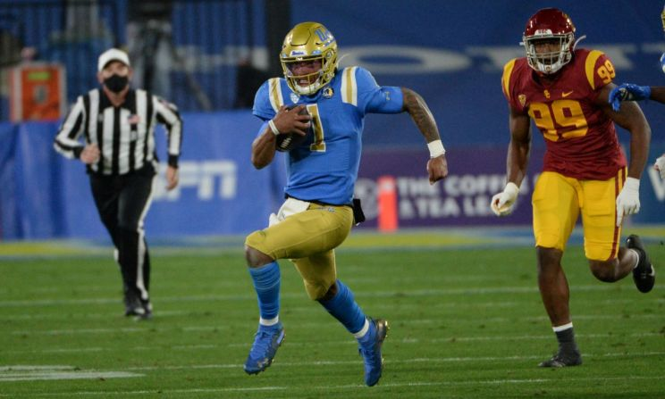UCLA quarterback rushed for 58 yards and passed for 364 yards and four touchdowns in the Bruins' 43-38 defeat to the USC Trojans at the Rose Bowl on Saturday, Dec. 12, 2020. Photo credit: UCLA Athletics