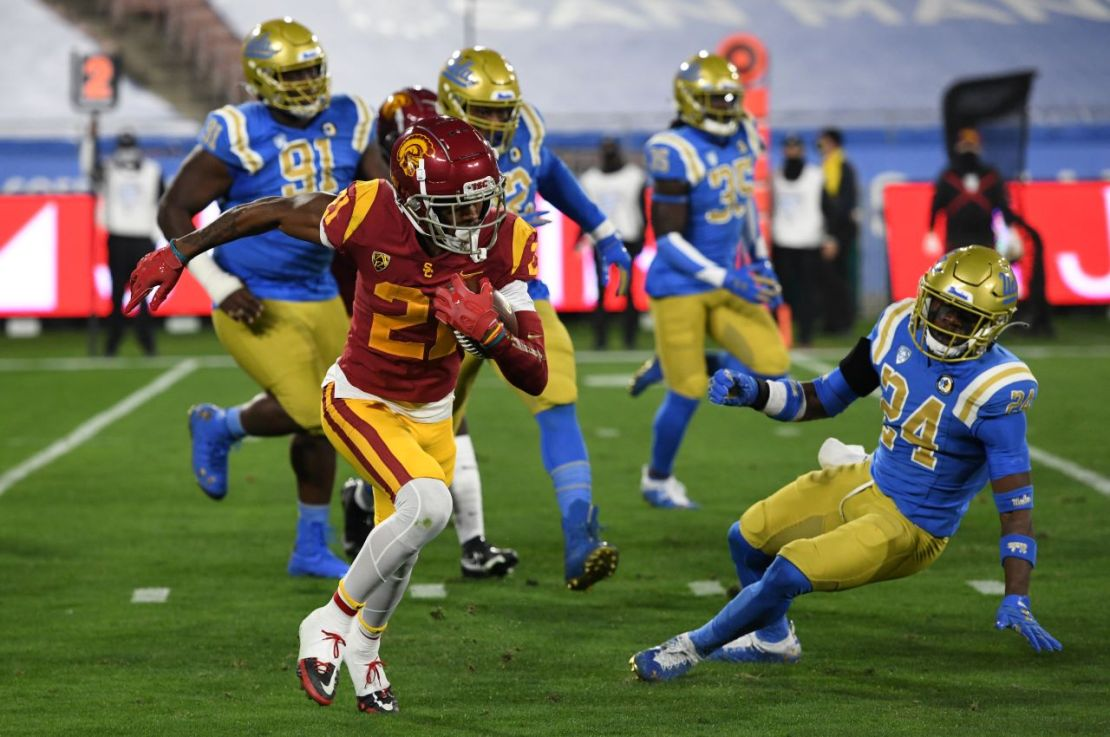 USC wide receiver Tyler Vaughns (21) with yards after the catch against UCLA on Saturday, Dec. 12, 2020. Vaughns had eight caches for 128 yards and a touchdown in the Trojans' 43-38 win against rival UCLA at the Rose Bowl. Photo credit: UCLA Athletics
