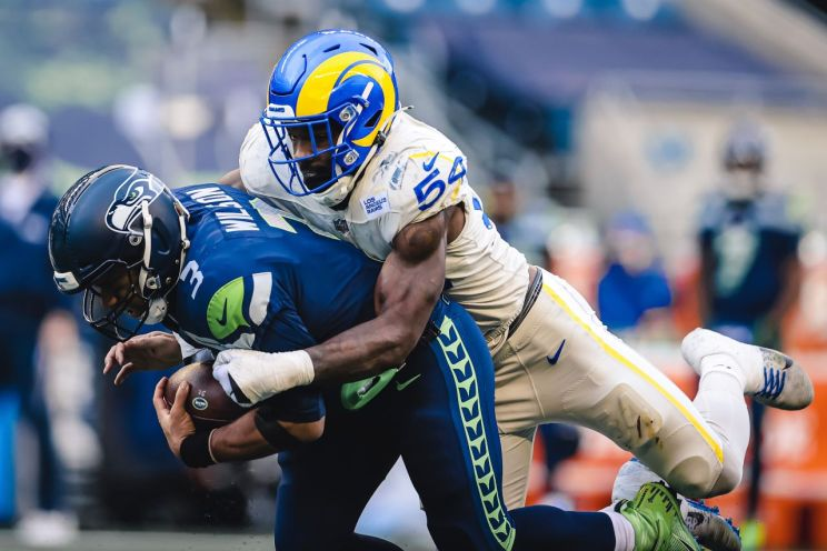 Los Angeles Rams linebacker Leonard Floyd (54) puts the squeeze on Seattle Seahawks quarterback Russell Wilson (3). Leonard and the Rams recorded five sacks against Wilson in a 23-16 November 15, 2020 win at Sofi Stadium. The Rams play the Seahawks in an NFC Wildcard game on Saturday, Jan. 9, 2021. Photo credit: Los Angeles Rams