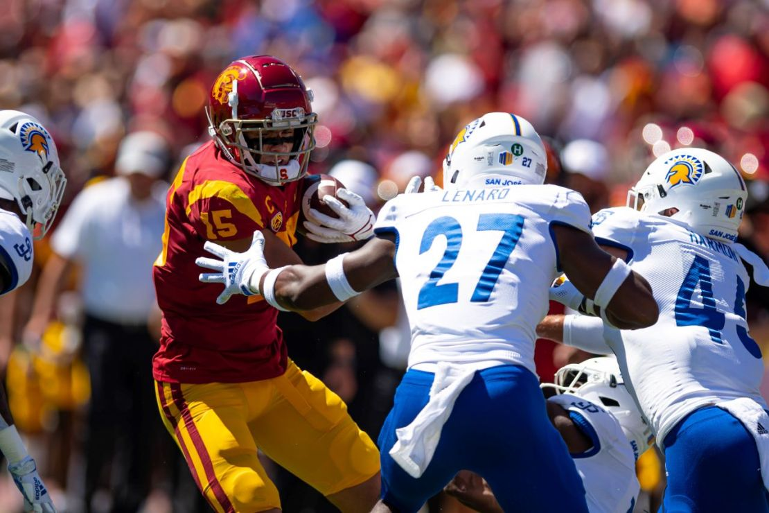 Sept. 4, 2021. USC wide receiver Drake London (15) goes for yards after the catch against a couple of San Jose State defenders. London caught 12 passes for 72 yards in the Trojans' 30-7 win. Photo credit: Sammy Saludo for News4usonline