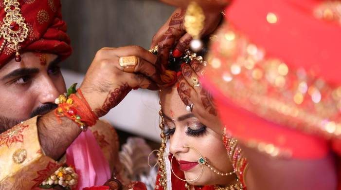 Weddings in pandemic: Smaller guest lists, temperature checks for safe celebrations