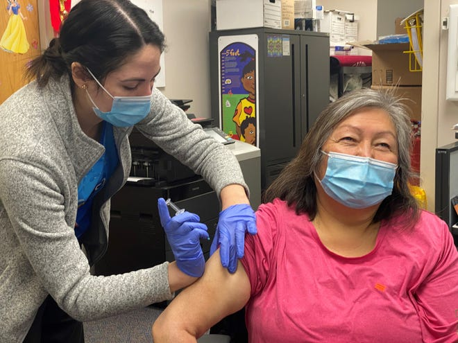 Native American tribes are receiving COVID-19 vaccines. Now health officials are working to ease fears about taking it.