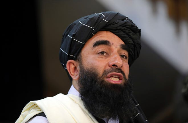 Latest on Afghanistan: Taliban blocks Afghans from going to airport, tells women to stay home