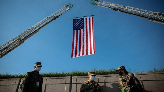 Americans honor lives lost in 9/11 terrorist attacks on 20 year anniversary