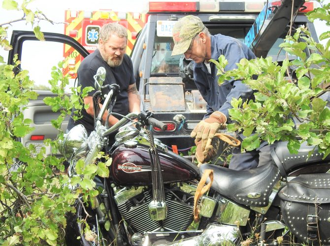 Motorcycle crashes into apple trees