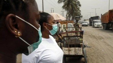Photo of Pandemonium as Chinese woman falls, starts vomiting at Nigerian Immigration Services in Lagos