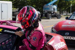 Ashton Harrison climbing in to her race car.